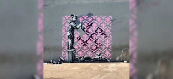 Banksy vuelve a las calles de París con grafitis sobre migración