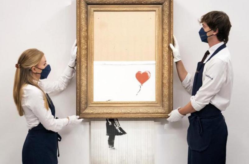 Video| El Banksy que se trituró justo cuando lo vendieron sale por 25.4 millones de dólares